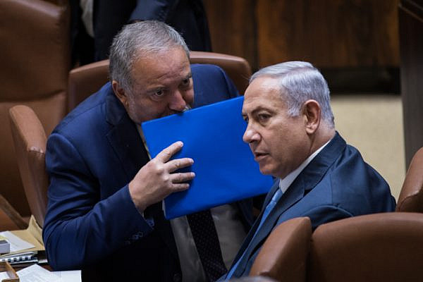 Avigdor Liberman and Prime Minister Benjamin Netanyahu seen at the opening winter session of the Knesset, October 23, 2017. (Hadas Parush/Flash90)