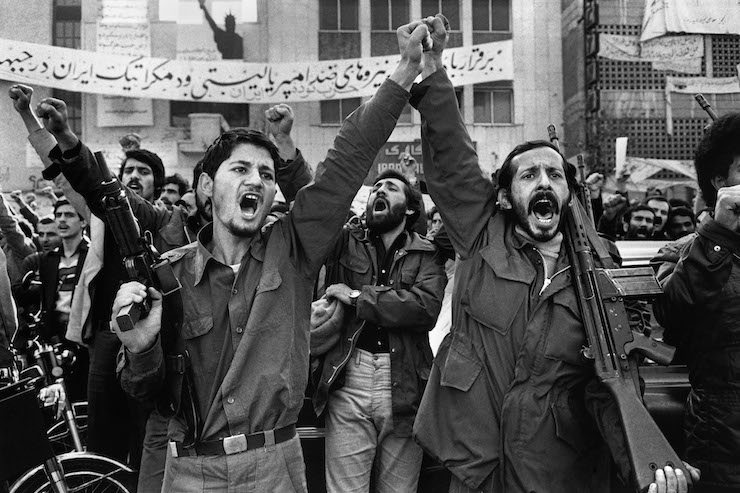 Armed left-wing protesters seen during demonstrations against the Shah's regime. behind of them is written: 'Long live anti-Imperialism and democratic forces,' January 1, 1979.