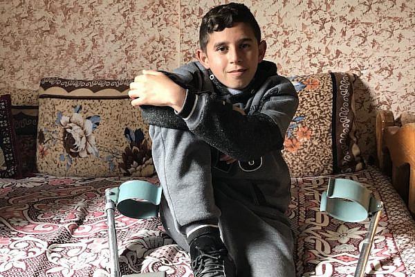 Mohamed Saleh in his home in Gaza. (Jen Marlowe)