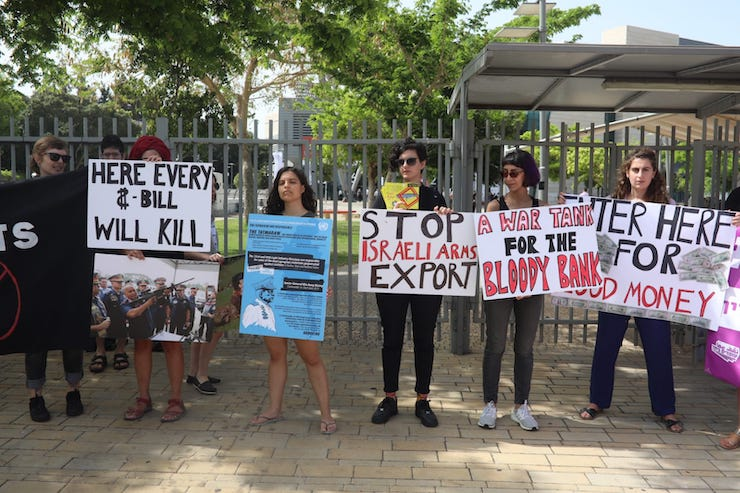 Human rights activists protest Israeli arms exports to Myanmar outside the ISDEF 2019 expo in Tel Aviv on June 4, 2019.