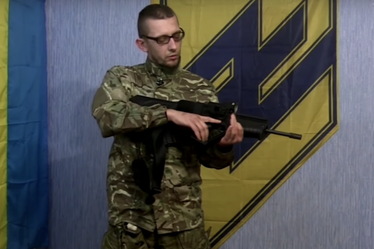 A soldier with the Azov Battalion seen holding an Israeli-made Tavor rifle. (Screenshot)