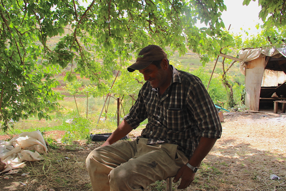 Maher Manasra seen sitting in his home village of Wadi Fuqin in the West Bank.