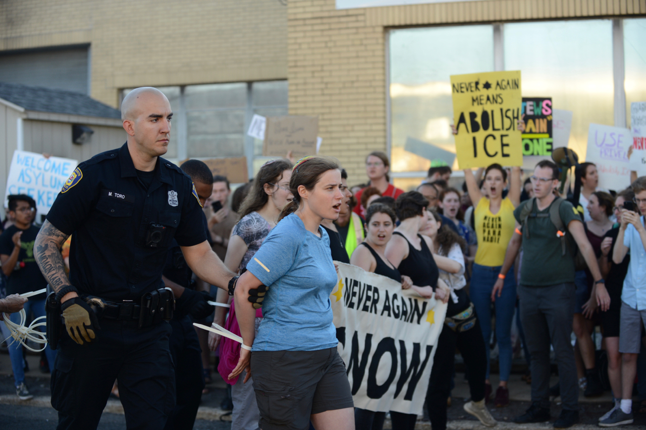 An American Jewish protester is arrested outside an ICE detention center in Elizabeth, New Jersey, July 1, 2019. (Gili Getz)
