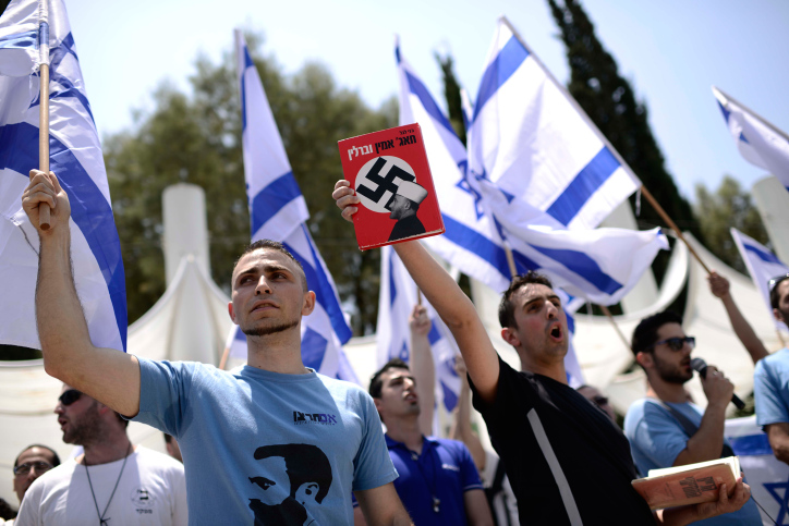 Israeli right-wing activists from the Im Tirzu movement demonstrate during a rally organized by Palestinian students at Tel Aviv University marking the Nakba, May 11, 2014. (Tomer Neuberg/Flash90)