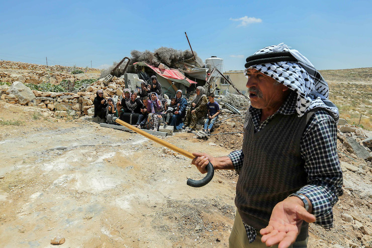 Palestinians look at a house which was demolished by Israeli authorities in the West Bank village of Khalat Aldabe, south of Yatta, June 17, 2019. (Wissam Hashlamon/Flash90)