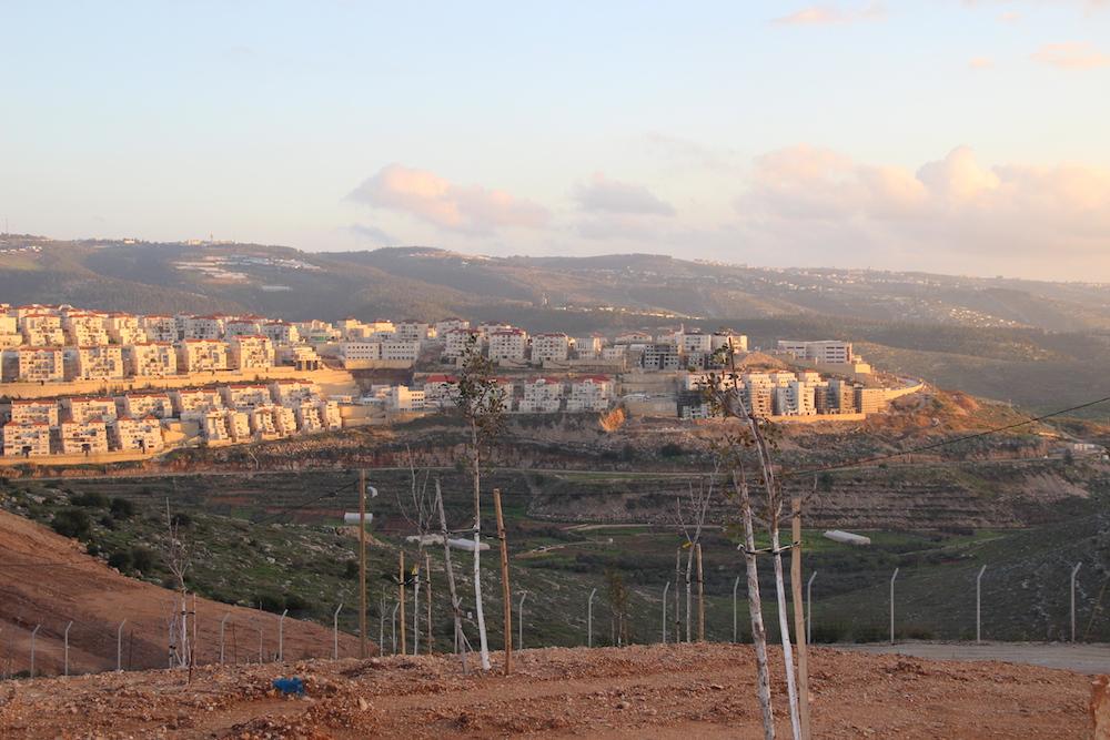The settlement of Beitar Illit, just east of Wadi Fuqin. (Arianna Skibell)