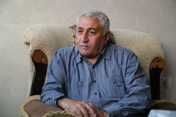 Atef el-Emawi heads the Gaza follow up committee for Palestinian refugees from Syria. (Mohammed Al-Hajjar)
