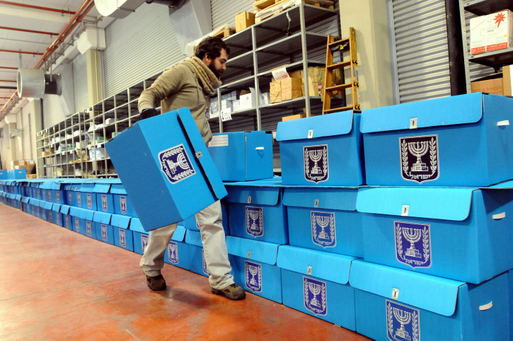 Illustrative photo of workers preparing ballot boxes for Israeli elections. (Yossi Zeliger/Flash90)