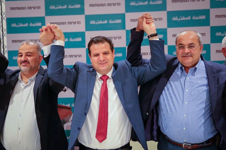 Mansour Abbas, Ayman Odeh, and Ahmad Tibi (left to right) join hands at the announcement of the return of the Joint List. (Photo courtesy of the Joint List)