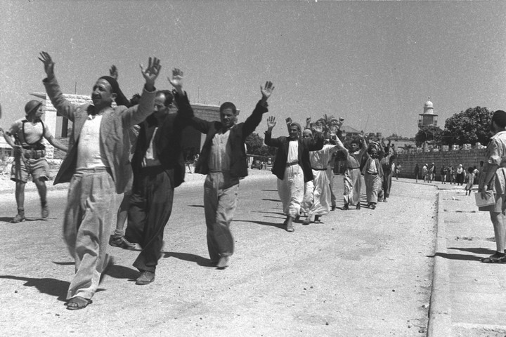 Palestinians in the city of Ramle surrender to Israeli forces during 1948 war. (Eldad David/GPO)