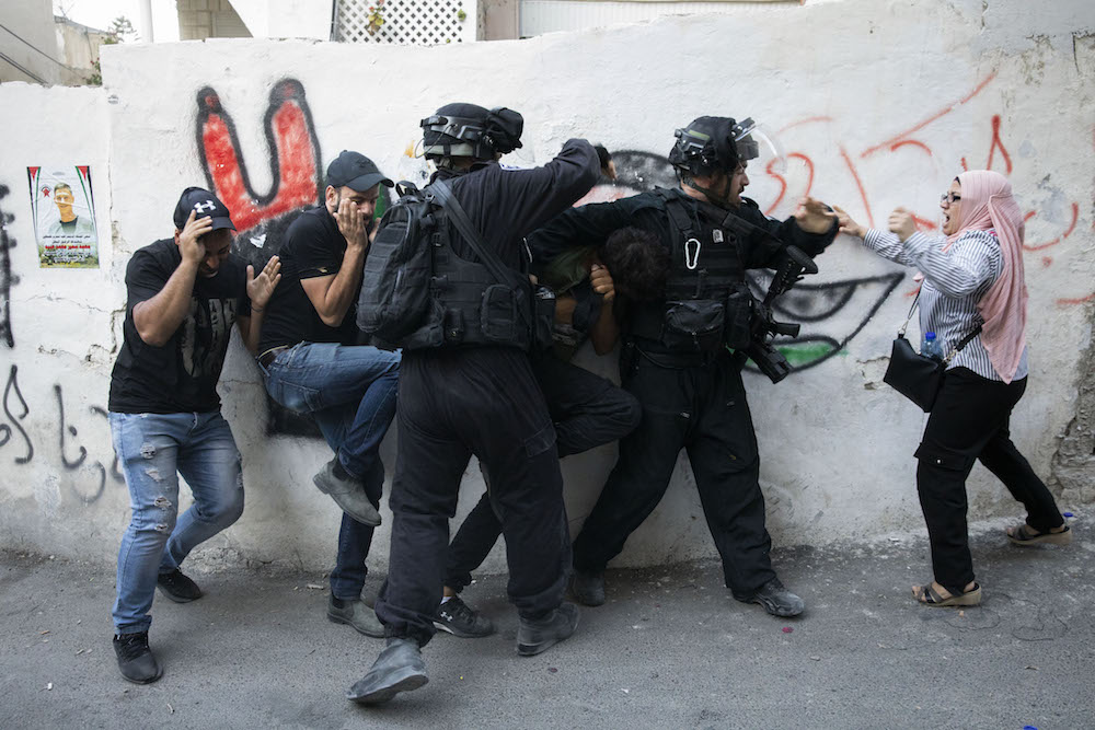 Israeli police officers seen confronting the residents of Issawiya during the funeral of Mohammad Obeid, who was shot dead by the police in late June, East Jerusalem, July 1, 2019. (Oren Ziv/Activestills.org)