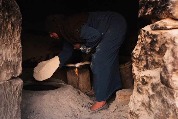 Zahriyah, Inshirah's mother, baking bread for breakfast in their home in the West Bank village of A-Tuba. (Rachel Shor)