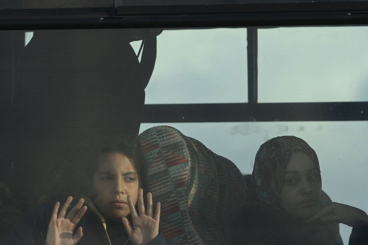 A Palestinian girl sits in a bus as she leaves Gaza with her family through the Erez crossing December 2, 2007. (Thair Alhassany/Flash90)