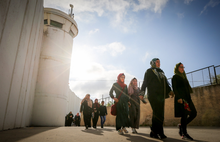 Palestinians make their way through an Israeli checkpoint to attend the first Friday prayer of Ramadan in Jerusalem's Al-Aqsa Mosque, near the West Bank city of Bethlehem May 10, 2019. (Wisam Hashlamoun/Flash90)