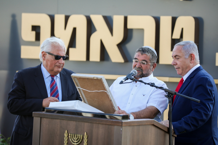 U.S. Ambassador to Israel David Friedman and Prime Minister Benjamin Netanyahu during an unveiling ceremony for 'Trump Heights' in the occupied Golan Heights, June 16, 2019. (David Cohen/Flash90)