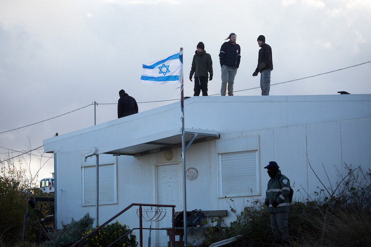 Jewish settlers prepare to resist an evacuation operation at the illegal outpost of Amona in the West Bank, February 1, 2017. (Miriam Alster/FLASH90)