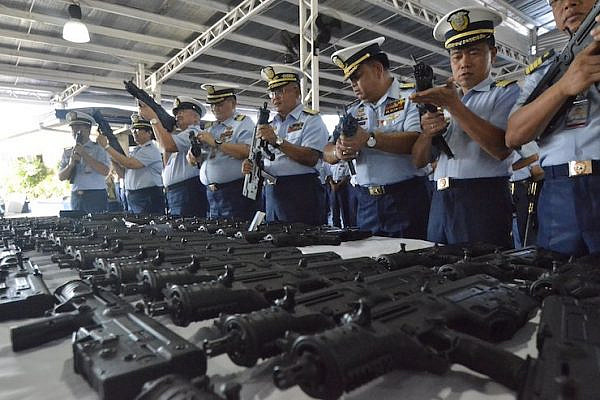 The Philippine Coast Guard presenting a shipment of 70 Israeli-made machine guns at the PCG National Headquarters Port Area on May 7, 2018. (Philippines Coast Guard)