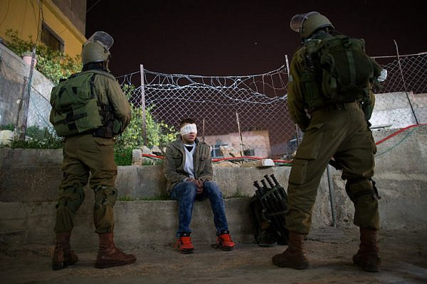 Illustrative photo of Israeli soldiers arresting a Palestinian man in the West Bank, on December 8, 2015. (Nati Shohat/Flash90)