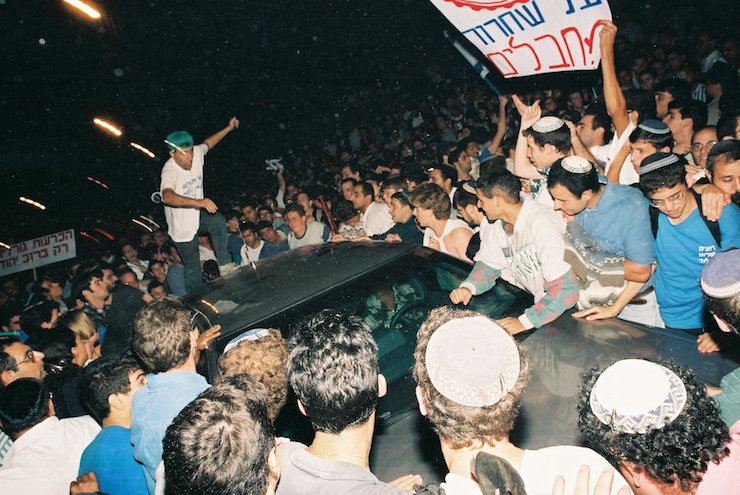 **file** Right-wing demonstrators pound on Prime Minister Yitzhak Rabin's vehicle during a protest against the Oslo Accords, in Jerusalem's Zion Square, October 5, 1995. (Flash90)