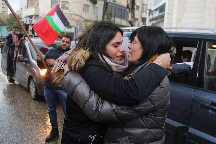 Palestinian legislator Khalida Jarrar of the Popular Front for the Liberation of Palestine (PFLP) hugging her daughter upon her release from an Israeli prison, in the West Bank city of Ramallah, February 28, 2019. (STR/Flash90)