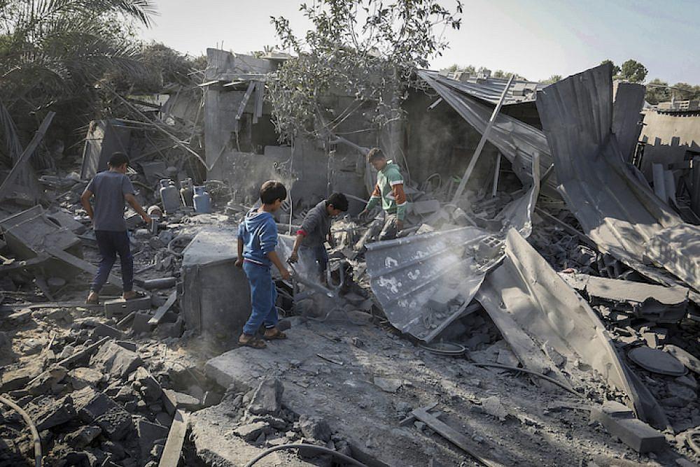 Palestinians survey the destruction following an Israeli air strike, in Khan Younis in the southern Gaza Strip, November 14, 2019.  (Abed Rahim Khatib/Flash90)