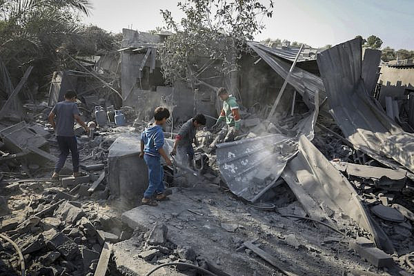 Palestinians survey the destruction following an Israeli air strike, in Khan Younis in the southern Gaza Strip, November 14, 2019.  (Abed Rahim Khatib/Flash90)