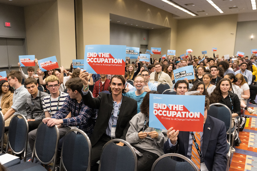 Attendees at the 2019 J Street National Conference raise posters of the organization's new campaign urging the Democratic Party to formally oppose Israel's occupation of Palestinian territory, October 27, 2019. (Photo courtesy of J Street)