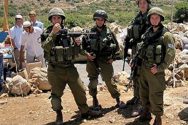 Israeli Soldiers Guard Settlers at an Illegal Outpost near Hebron. Photo: Mairav Zonszein)