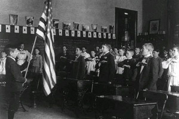 Pledging allegialnce to the flag in a US school, early twentieth century.