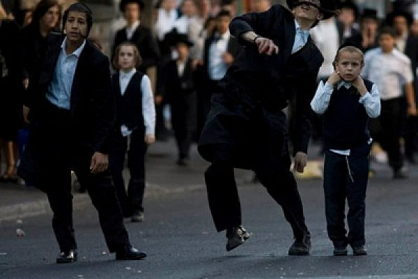 Ultra-Orthodox protesting the opening of a parking lot in Jerusalem (photo: Oren Ziv/activestills.org)