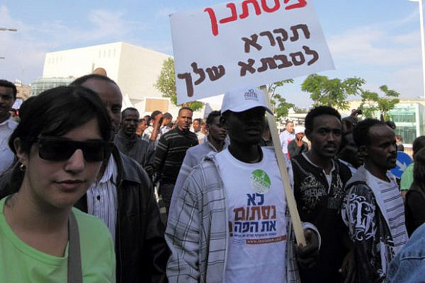 Refugees march in the Human Rights March, 2010