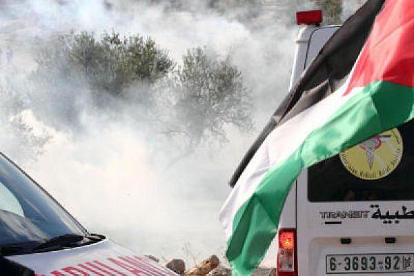 Ambulance under CS gas attack, Bil'in (Yossi Gurvitz)