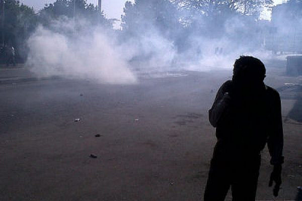 Protesters under tear gas attack, Cairo (Flickr user Monasosh, creative commons)
