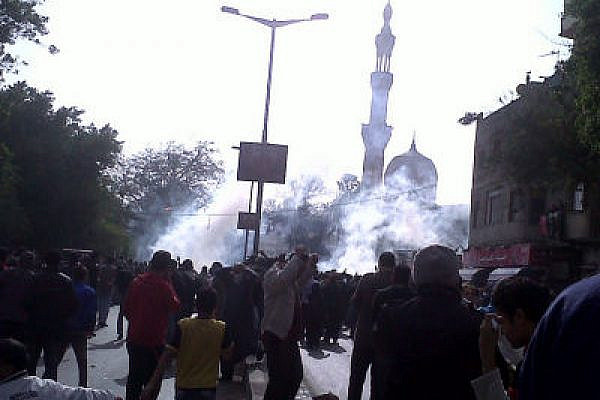 Demonstrators in Cairo, under tear gas attack (Flickr user Monasoh, creative commons license(