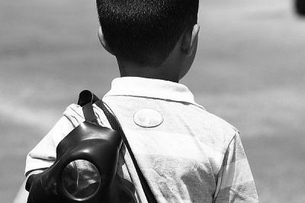 A child in Bil'in, carrying a gas mask (Yossi Gurvitz)