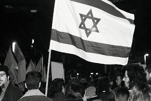 Can this flag stand for all its citizens or only the Jewish ones? Photo: Yossi Gurvitz
