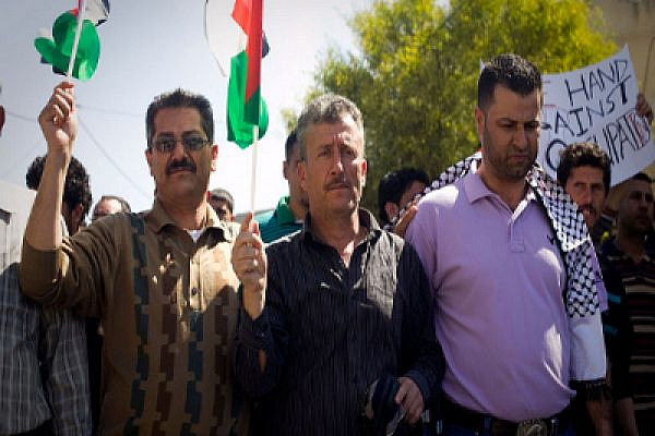 Bassem Tamimi of Nabi Saleh in Bil'in last Friday with Abdallah Abu Rahmah. Photo: Oren Ziv/Activestills.org