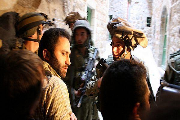 Issa Amro with Israeli activist Jonathan Pollak at a demonstration in Hebron last year. Photo: Joseph Dana