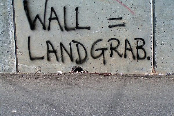 "Graffiti ""Wall=Landgrab,"" Abu Dis, September 2005 (Photo: Bright Tal (Political)/Flickr)"
