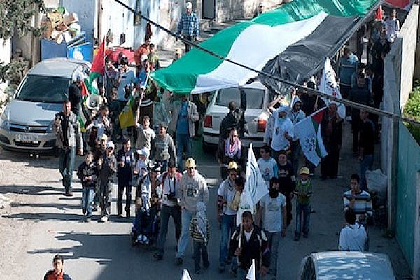 West Bank Palestinians protest against Israel's separation wall. (Photo: Ian McKellar/Flickr)
