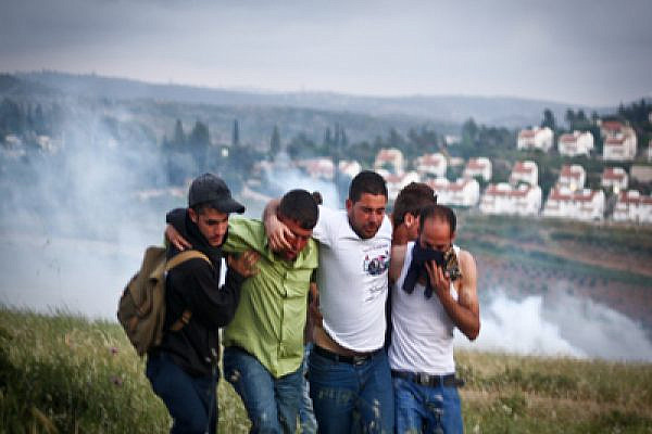 Palestinians suffer from tear gas in Nabi Saleh Photo: Joseph Dana