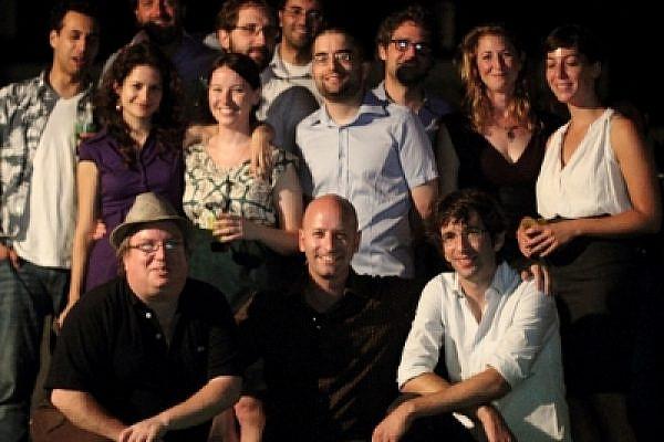 +972 team at 1st year toast. standing (left to right): Mairav Zonszein, Dahlia Scheindlin, Joseph Dana, Roi Maor, Aziz abu-Sarah, Dimi Reider, Shir Harel, Noa Yachot, Yuval Ben-Ami & 972's friend Issa Edward Bourseh. kneeling: Noam Sheizaf, Ami Kaufman, Yossi Gurvitz (photo: Shalom Boguslavsky)