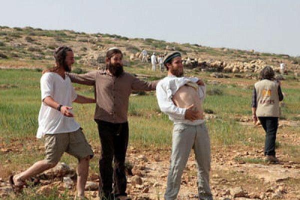 Settlers harass Palestinians in Susyia (Photo: Activestills)