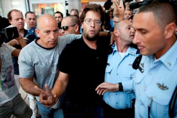 Israeli activist Matan Cohen being detained by police at Ben Gurion airport (photo: Oren Ziv / activestills.org)