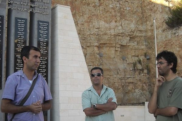 Aziz and other speakers in Beit Jann soldiers memorial while on narratives tour (August 2011)