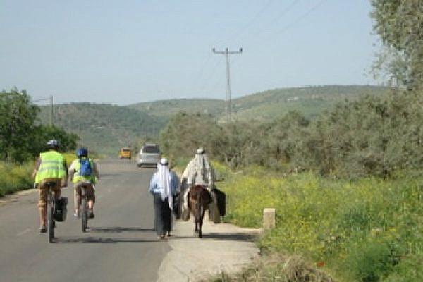 Riding through the West Bank (Photo: Olivia Snaije)