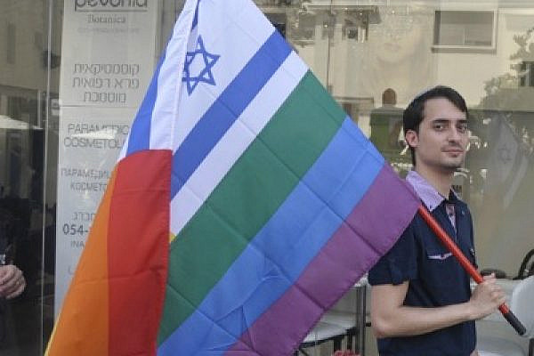 Israeli walks with flag during Tel Aviv gay pride (photo: wanderlasss/Flickr cc)