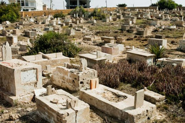 """Graves desecrated in Jaffa in a """"price tag"""" attack. (Photo: Activestills)"""