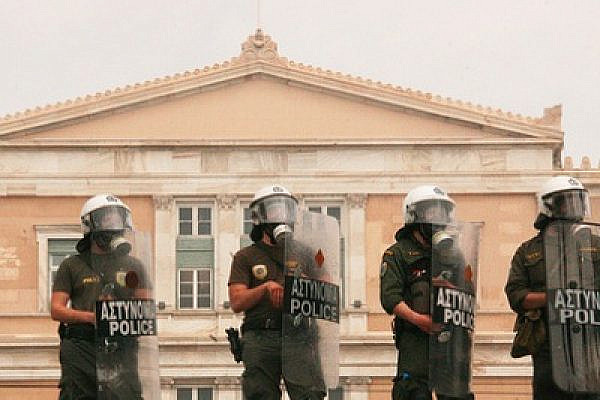 Greek riot police facing anti-austerity demonstrators (George Laoutaris/Flickr)