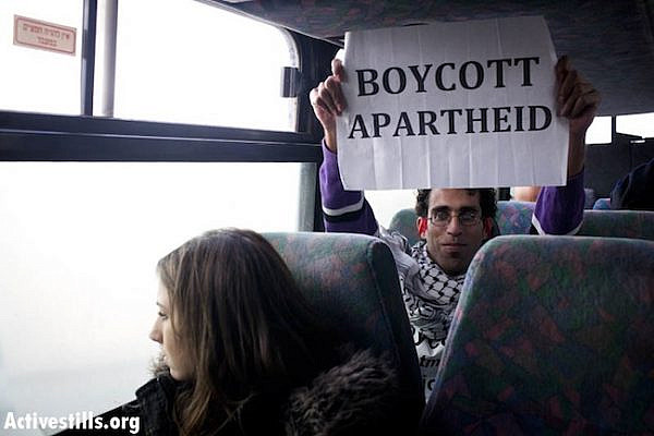 Basel al-Araj, a Palestinian who was killed during a gunfight with Israeli soldiers on March 6, 2017, is seen in November 2011 during a Freedom Ride on a settler-only bus in the West Bank. (Activestills.org)
